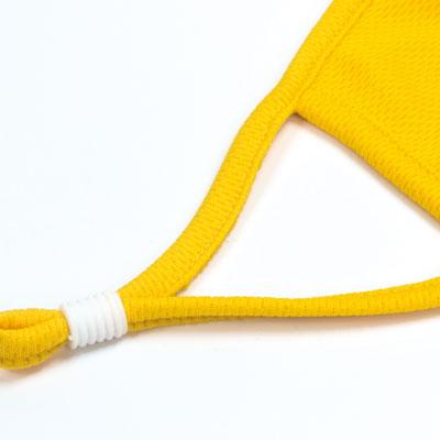 yellow face mask piping